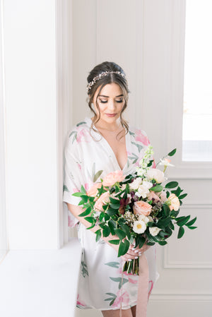 bridesmaids wearing pink and white floral peony robe for getting ready