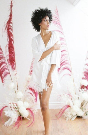 swan robe in white bridal with ostrich feather trim, for the modern bride