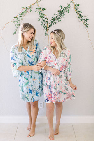 Bridesmaids getting-ready wearing the light blue capri print robe from by catalfo