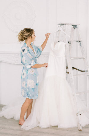 bride in floral robe for an intimate toronto wedding