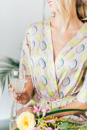 Blush and sage green bridesmaid robe in a tropical lemon print