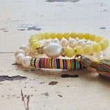 Boho Chic African Vinyl & Quartz Tassel Stretch Bracelet at $115