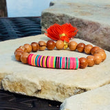Colorful African Vinyl Stretch Bracelet w Bright Colour Tassel on Bayong Wood at $42