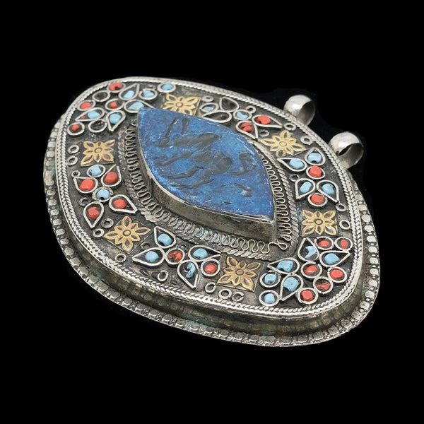 Vintage Turkmen pendant with imprint of an antelope