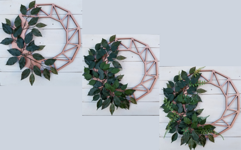 adding greenery to a wreath