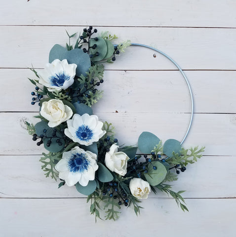 adding finishes touches to a metal wreath