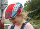 Emmy wearing Hanna Hats Children's Cap Bright Patchwork Tweed