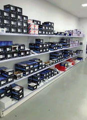 Retail shelving along wall in Equipment Traders showroom