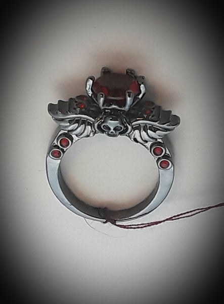 Angel wings and skull ring red gems size 8