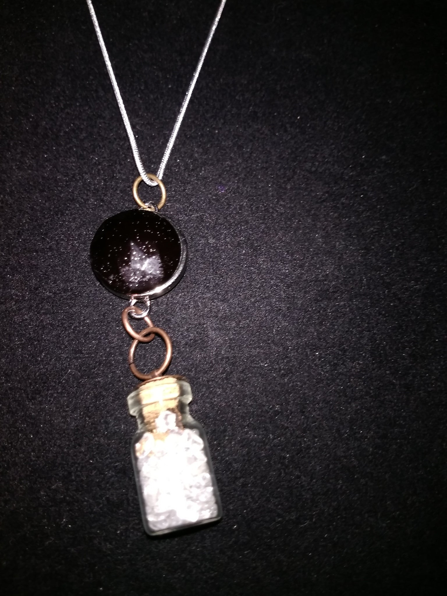 Crystals in a bottle gem necklace with removable snap