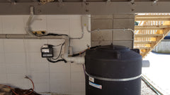 Bioreactor with controller and blower mounted on the wall