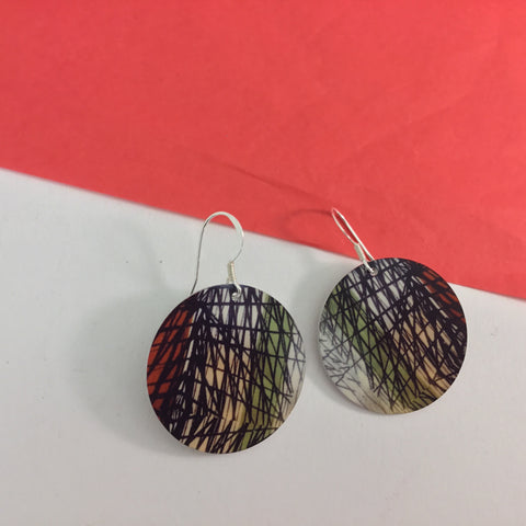 Drop disc handprinted domed earrings. Handmade jewellery. Made in London. Inspired by 1950s fabric design..