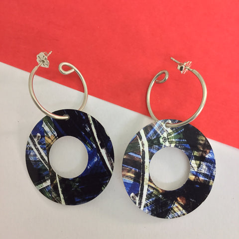 Jewellery / earrings. Sterling silver handmade hoops with open circle printed discs.