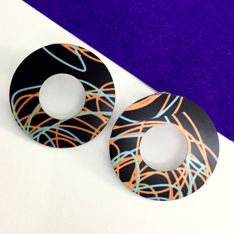 Jewellery. Handprinted handmade open circle stud earrings. Sterling silver posts.