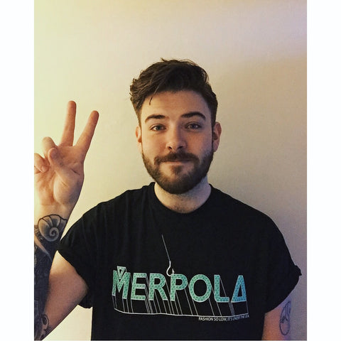 Toby King Merpola Founder Director Hooked Mermaid Logo Tee About Us Page