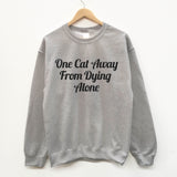 One Cat Away From Dying Alone fun slogan sweatshirt - SimpleThingsCards
