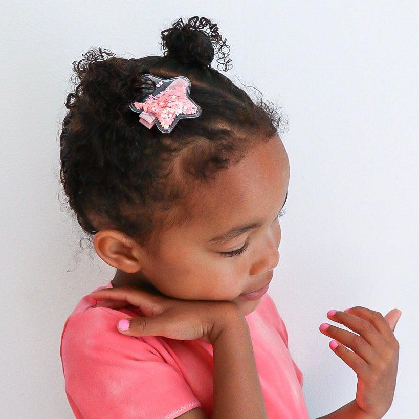little girl wearing a star glitter shaker no slip hair clip