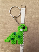 Dinosaur party favors - Set of 8 keychains or zipper pulls!