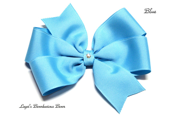 small blue bow, medium blue bow, large blue bow, extra large blue bow, blue pinwheel hair bow