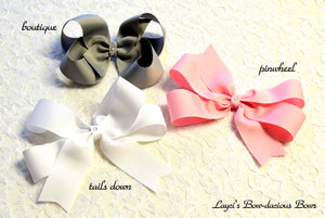 extra large boutique, pinwheel, tails down hair bows, cheer bows