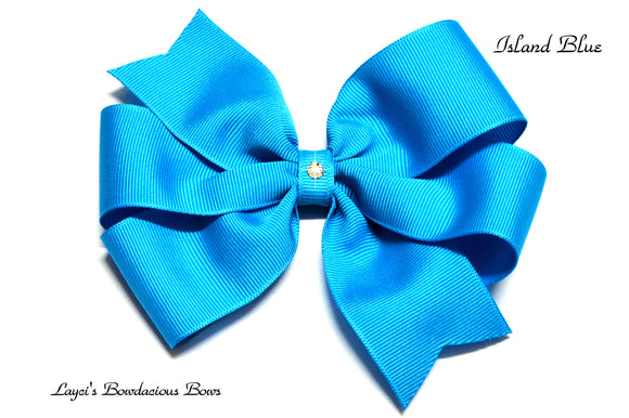small island blue bow, medium blue bow, large blue bow, extra large blue bow, blue pinwheel hair bow