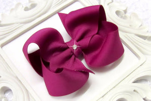 large festive fuchsia boutique hair bow