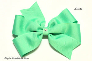 small lucite bow, medium green bow, large green bow, extra large green bow, green pinwheel hair bow