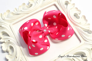 Shocking pink polka dot bow