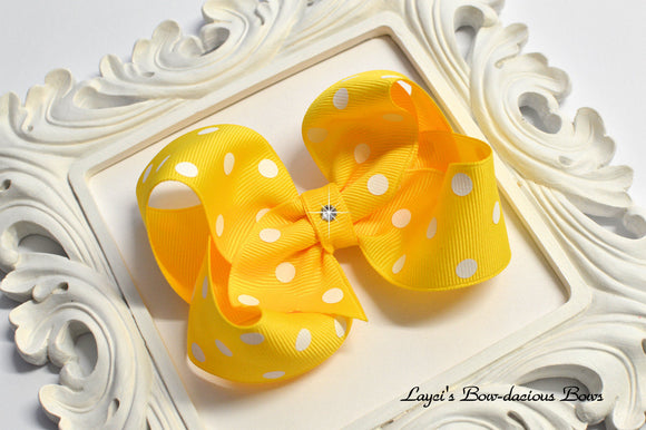 yellow polka dot bow