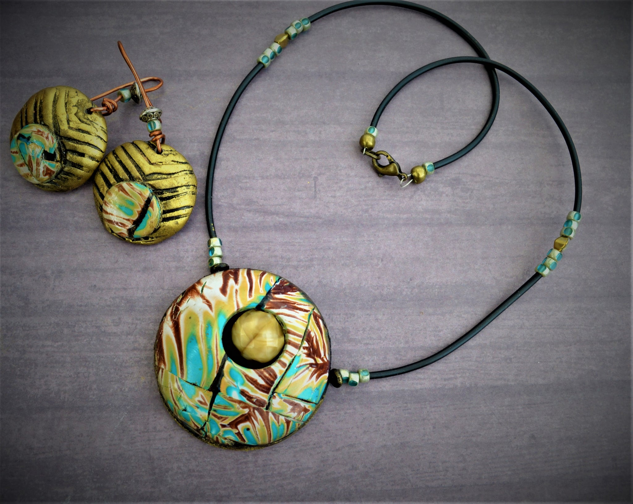 Hollow polymer clay bead necklace with earrings using Mokume Gane