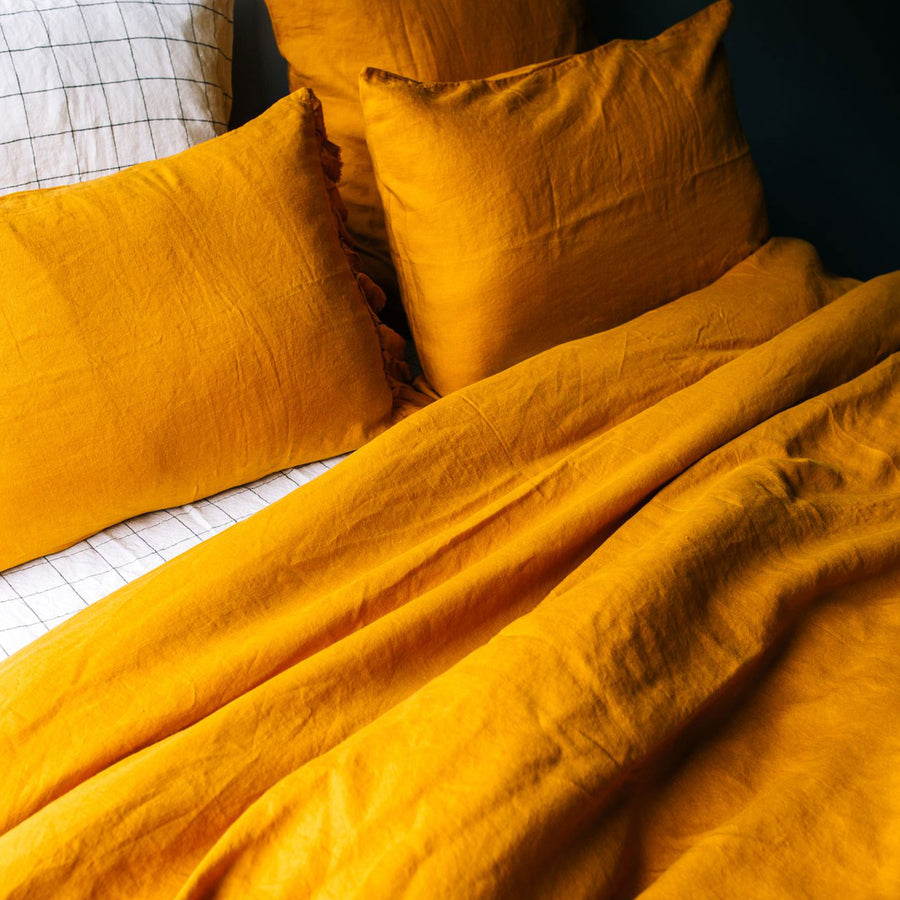Toetoe Linen Duvet Cover Ochre with Marble Grid Sheet and Pillow