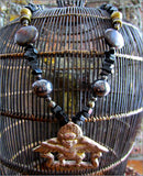 Tibetan Khyung Garuda Pendant on Rich Gemstone Strand