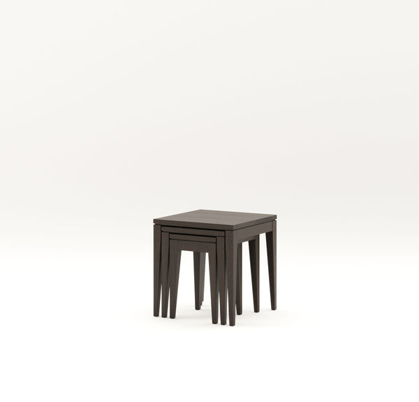 Dark stain solid timber square top side tables with negative detailing around tops and tapered legs nested together on plain white background