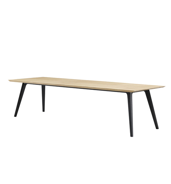 Solid rectangle timber dining table with blonde oak timber top and tapered flared black timber legs