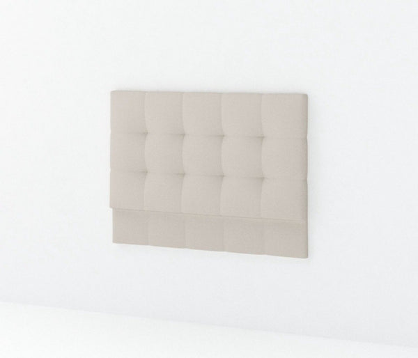 Light grey fabric upholstered rectangle headbaord wtih soft pulling quilt detail on plain white background