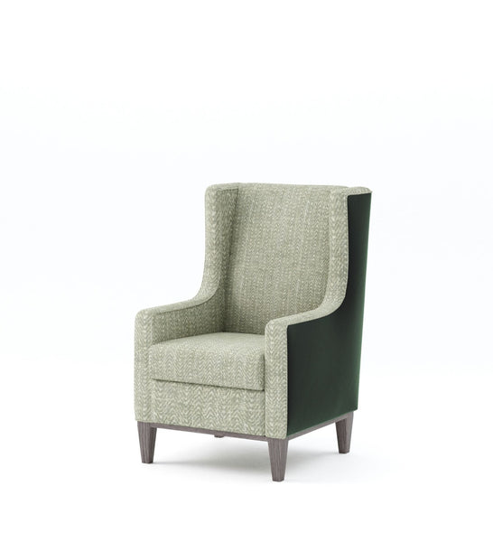 Soft green and white chevron pattern wing back chair with piping and contrasting dark green leather back with grey wash solid timber base and tapered legs on plain white background