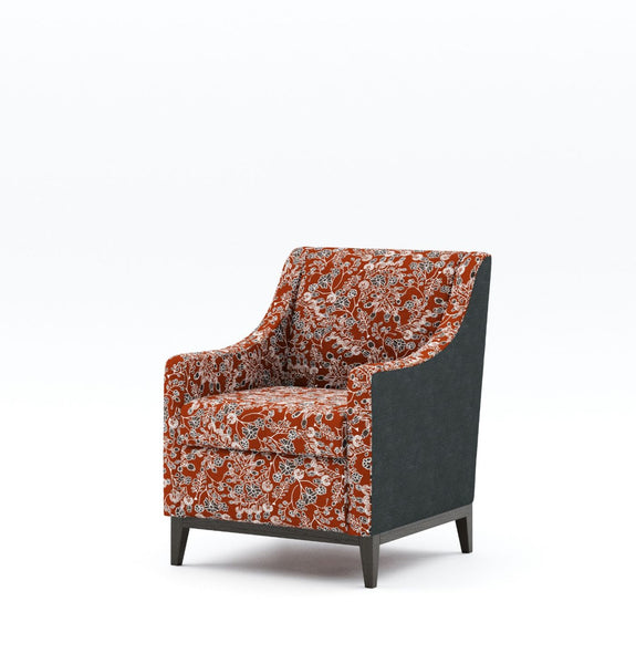 Rust orange floral pattern mid back chair with contrasting dark charcoal fabric on outside of chair and dark charcoal timber base and legs on plain white background