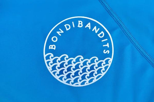PREORDER ONLY - Neon Blue Waves Bondi Bandits Rashie