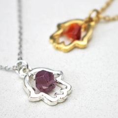 close up of Lucky Hamsa Birthstone Charm Necklace silver and gold