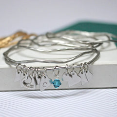Antique silver bangles set with heart charms and crystals