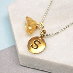 Close up of Personalised Initial Birthstone Necklace gold