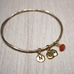 Gold birthstone hope mantra bangle close up