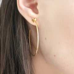 Close up of Heart Hoop Earrings gold