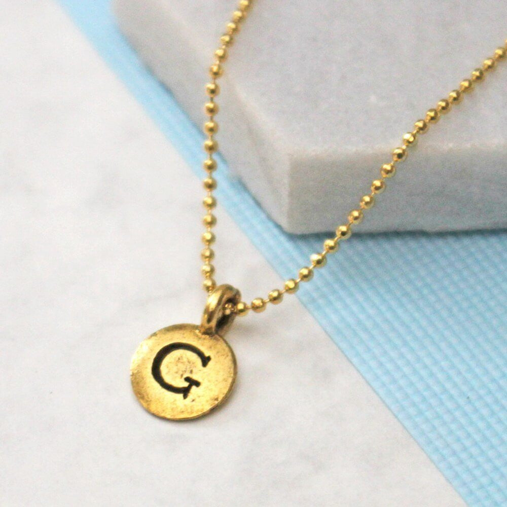 Close up of Bespoke Initial Necklace gold