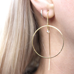 Close up of Thread Through Hoop Earrings gold