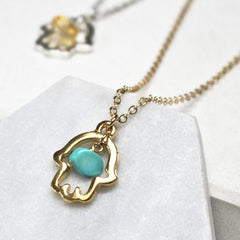 Close up of Lucky Hamsa Birthstone Charm Necklace gold