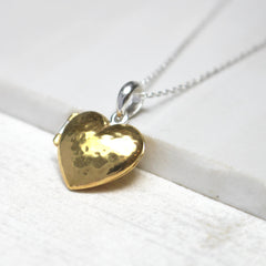 Close up of Personalised Message Heart Locket Necklace gold