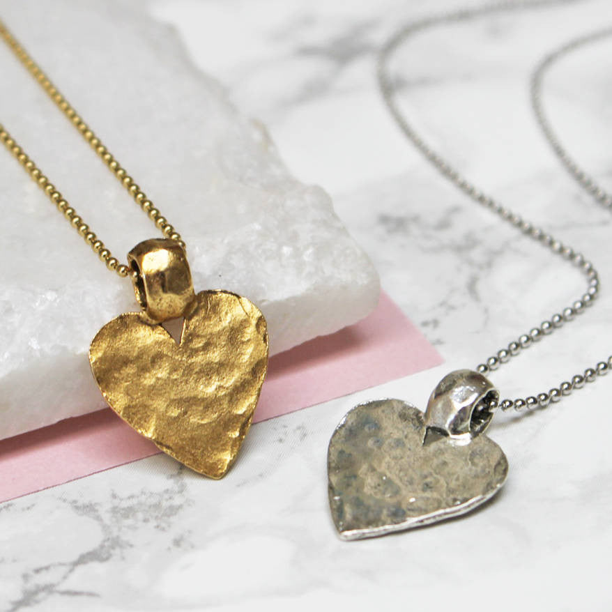 Close up of Hammered Gold And Silver Heart Pendant