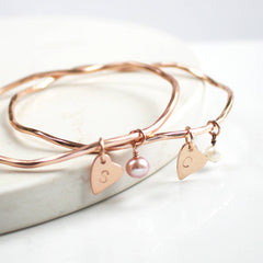 Rose gold personalised bangle with pearls and heart charms