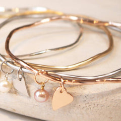 Close up of heart and pearl personalised bangle